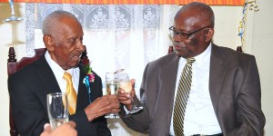 Governor General Sir Elliott Belgrave (right) toasting Frank Moore earlier this year.