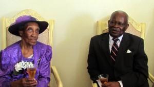 Governor General Sir Elliott Belgrave toasts centenarian Viola Haynes.