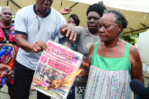 Angry residents threaten to burndown Newsday.