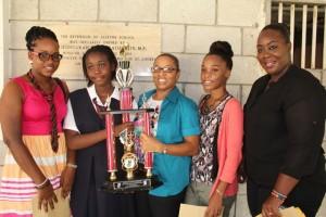 Teacher Deborah Bascombe (centre) with honourees and Alleyne stars (from left) Sammy G, Quinn P, Mandisa and Chrystal Cummins-Beckles.