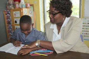 Maxine Husbands with one of the boys in the infants school.