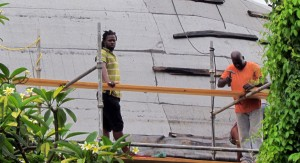 Workers doing some remedial work to the church's roof.