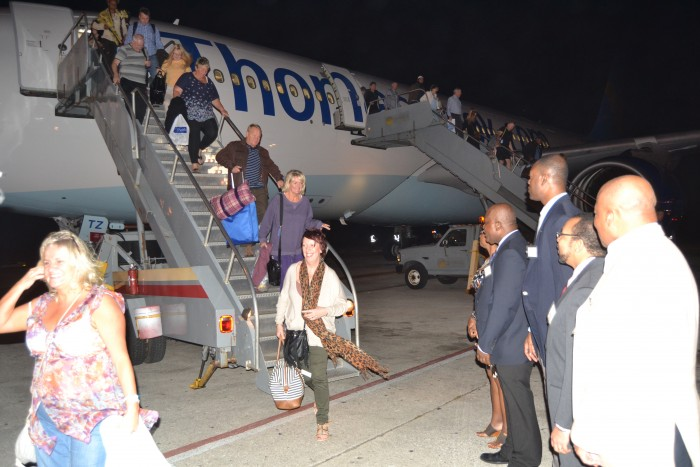 Passengers arrive on the first scheduled Thomas Cook flight into Barbados on Sunday evening.