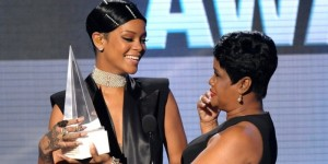 Rihanna with her Icon Award after being presented it by her mother Monica Fenty