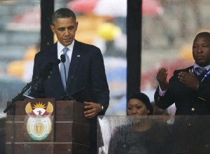 President Barack Obama looks down as he stands next to the sign language interpreter as he makes his speech at the memorial service for former South African president Nelson Mandela. (Photo: AP/Matt Dunham)
