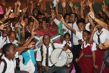 Joining the excited team and students after the resounding victory was principal Matthew Farley (fifth from right).
