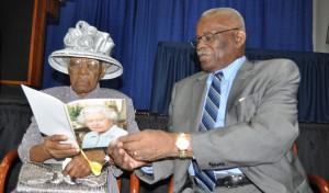 Centenarian Eilene Walkes looks at her birthday with Governor General Sir Elliott Belgrave.