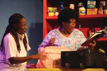 """Toni-Ann Johnson (left) is finding getting into hospital a rather difficult task, made doubly so by """"Nurse"""" Peta Alleyne."""