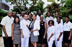 General manager of The House, Joanna Roterberg (centre), with members of her team celebrating receiving three Tripadvisor's Travellers Choice Awards for 2014.