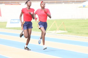 Under-15 girls division champion Shemia Odaine of Haynes House (left) settling for second place in the 200m which was won by Chloe Lucas also of Haynes House.