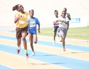 St. George Primary's Sarah Belle about to win the U-13 200M.
