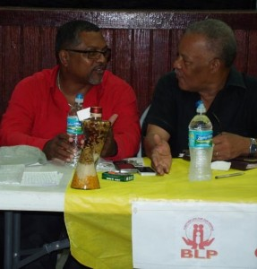 BLP candidate for St Philip North in the 2013 elections, Indar Weir, chatting with Owen Arthur during the meeting of the Christ Church West Central branch last night