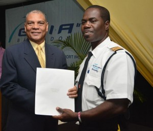 Director of finance at GAIA, Henry Barrow, presenting certificate to Bertram Holder.