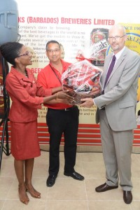 A token of appreciation for EU Ambassador Mikael Barfod (right) from Banks Breweries group public relations manager Sophia Cambridge and Ray Chee-A-Tow.