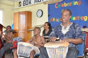 Historian Trevor Marshall (right) joined the boys of Eagle Hall Primary on the drums.