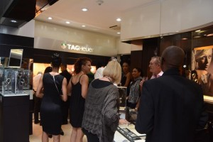 Some of the guests at the brand awareness reception examining the luxury Tag Heuer timepieces.