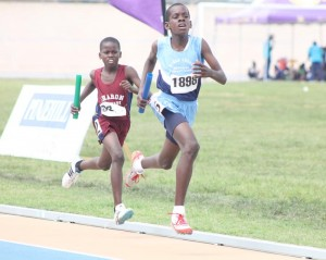 Luther Thorne Primary's Shem Williams came from behind to win this U-13 medley relay.