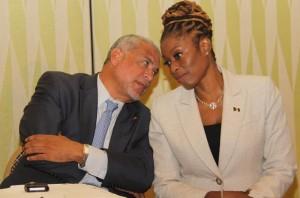 Parliamentary Secretary in the Ministry of International Transport, Senator Irene  Sandiford-Garner chatting with Antigua's International Transport Minister John McGinley.