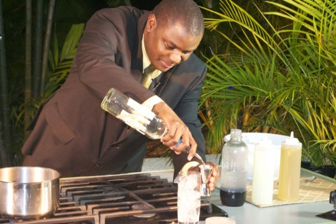 Master mixologist Jamaal Bowen preparing his first drink of the night, coconut ginger cooler.