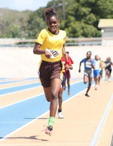 Sarah Belle of St George Primary winning her heat of the open girls' 600M.
