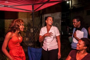 Shakirah Bourne (standing right) sharing a light moment with lead actresses Alison Hinds (centre) and Saran Lashley from the movie Two Smart.