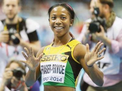 Jamaica's Shelly-Ann Fraser-Pryce celebrates after winning the women's 60m final in the World Indoor Athletics Championships at the ERGO Arena in Sopot, Poland, Sunday. — Reuters