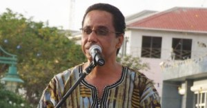 President of the Clement Payne Movement, David Comissiong, addressing the tribute to Kamau Brathwaite concert.