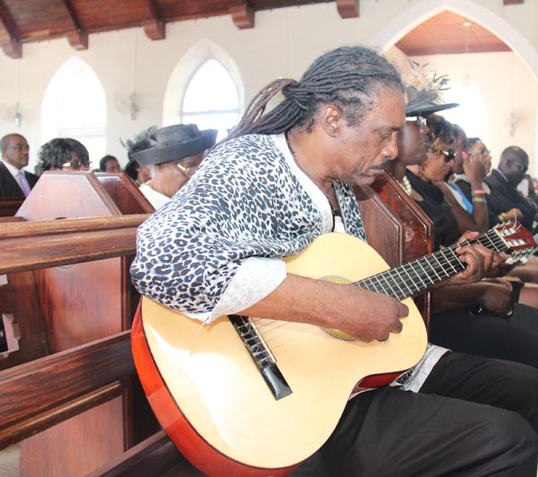 Calypso maestro the Mighty Gabby, accompanied soloist Marielle Shorey on guitar in her musical tribute.