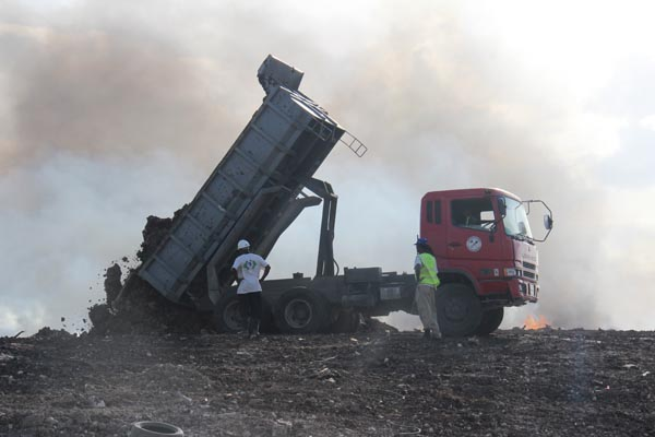 Trucks from the Sanitation Service Authority and other private contractors transported tonnes of topsoil from the nearby Sustainable Barbados Recycling Centre to help smother the blaze.