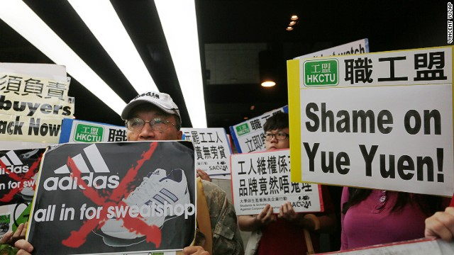 Labor activists protest in front of an Adidas office in a Hong Kong shopping mall