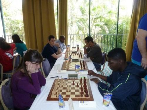 Orlando Husbands (right) battling woman grandmaster Diemante Daulyte of Latvia.