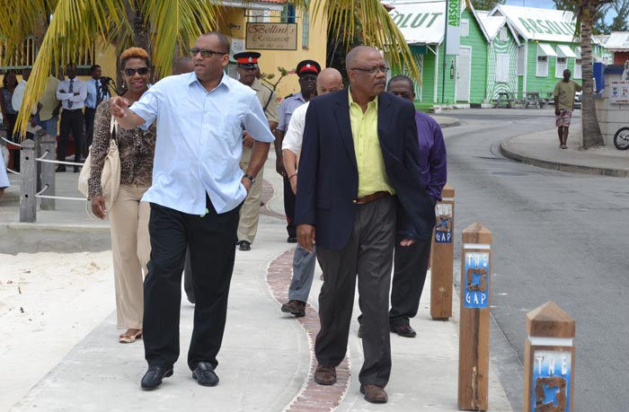 Minister of Tourism Richard Sealy (left) led a walk-through of St Lawrence Gap today, promising to ensure that it remains safe for visitors. (Picture by Rollin Williams.)