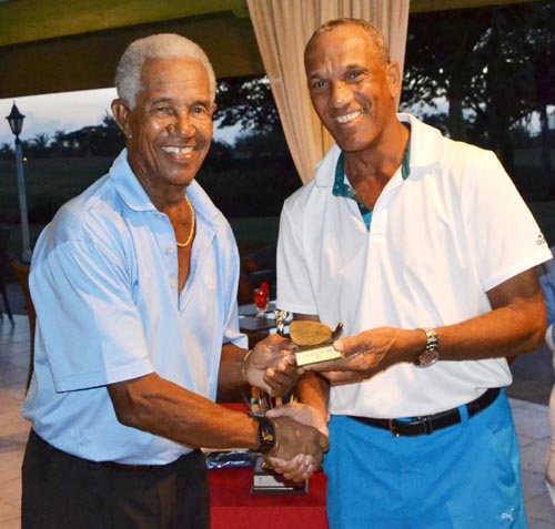 Sir Garfield Sobers, winner of the closest-to-the-pin prize, accepting his award from BGA President Cally Boyea.