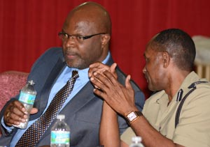 Attorney General Adriel Brathwaite (left) and Acting Commissioner of Police Tyrone Griffith at today's meeting.