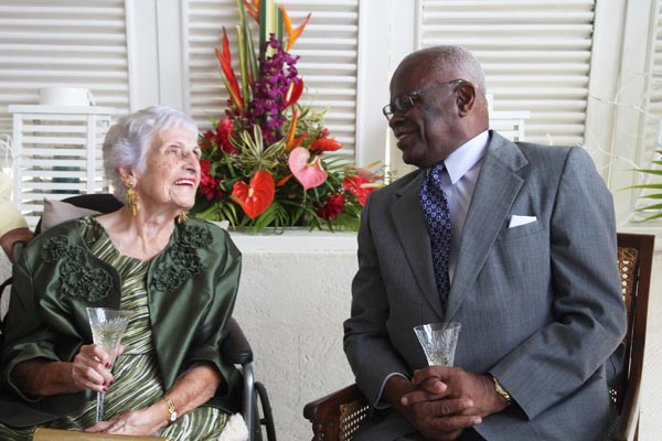 Beulah Mackie (left) expressed her delight at reaching a century and being in the company of Governor General Sir Elliott Belgrave.