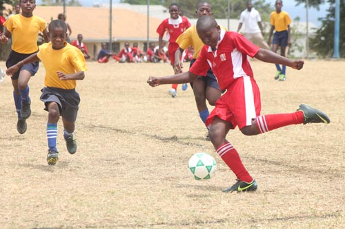 Diallo Marshall of St. Stephen's Primary preparing to launch a powerful left foot shot.
