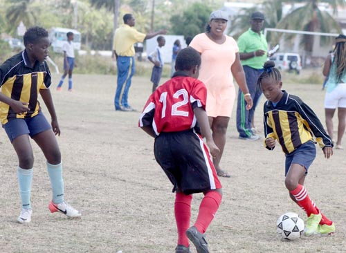 Girl power - St. Lucy's Agape Henry (left) and Zariah Greaves (right) about to go past the Half Moon Fort defender.