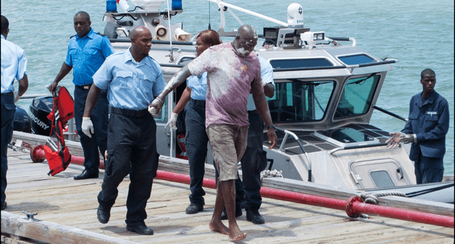 Percel Griffin (without shoes) being assisted by EMS workers on arrival at Deep Water Harbour in Antigua yesterday