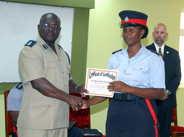 Sargeant Jacqueline Bourne receives her certificate from ACP Oral Williams.