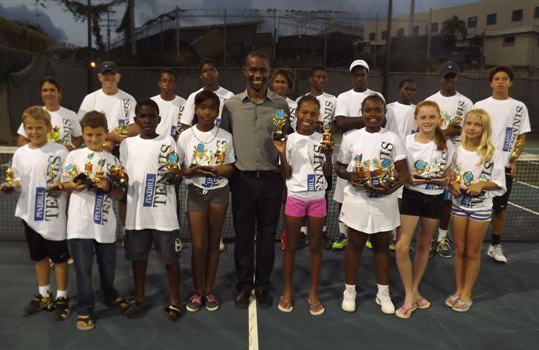 Some of the tennis competitors posing with Pine Hill's Henry Yearwood (centre).