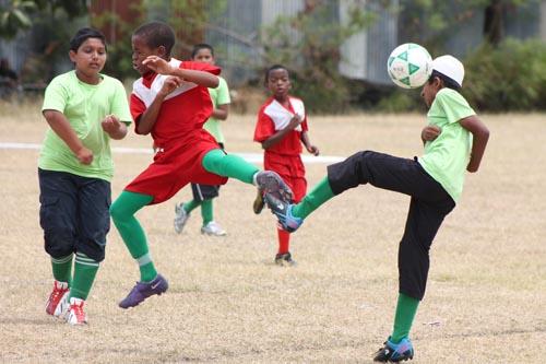 St. Mary's striker Jahshawn Goodman (centre) and Al Falah defender Ibrahim Adam (right) battling for ball possession.