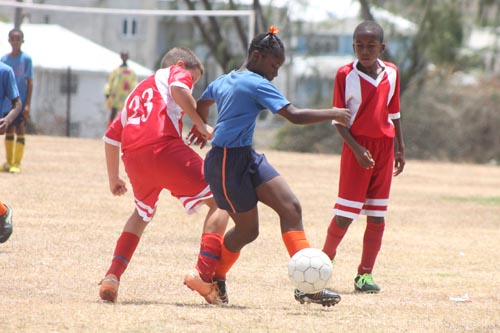 Vauxhall Primary's defender Olianne Bishop dribbles her way past a St. Angela's player.