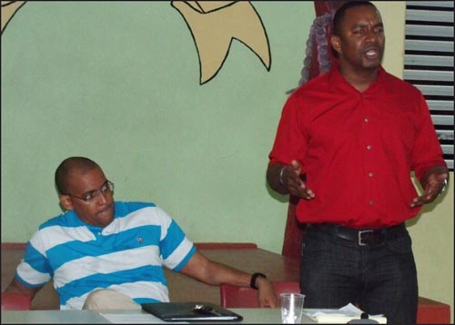 Senator Wilfred Abrahams speaking at last night's BLP Christ Church East branch meeting, as Kerrie Symmonds listens.