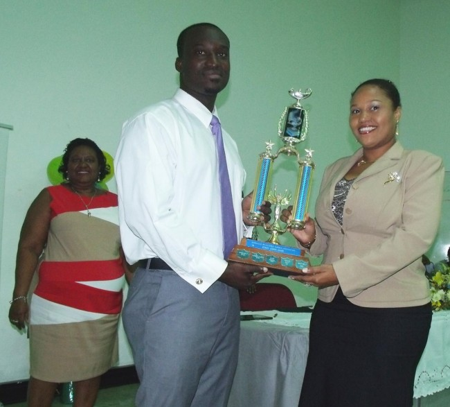 Nurse Bernard Beckles (centre) receiving the Eunice Gibson Award for the 2014-2015 year from the past year's award recipient Marlo St Hill. At left is Barbados Registered Nurses Association president Blondelle Mullin.