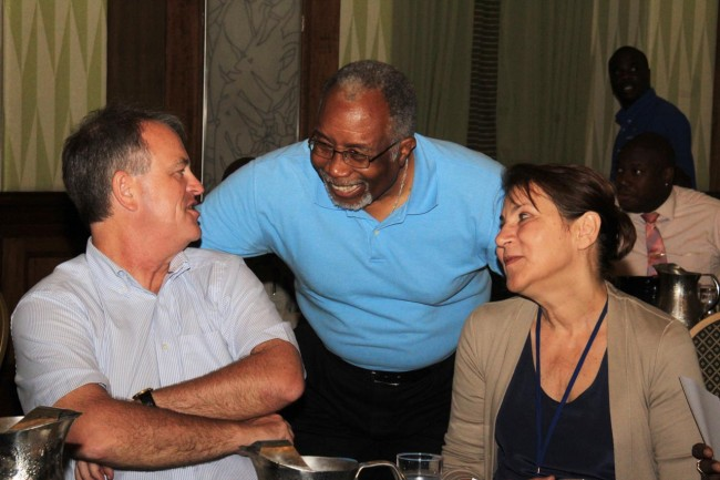 Disaster risk management consultant and former CERO director Clive Lorde (centre) and other participants in today's CDM consultation having a good laugh during a break.