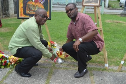 MP Trevor Prescod (l) was among officials who laid wreaths at this morning's activity.