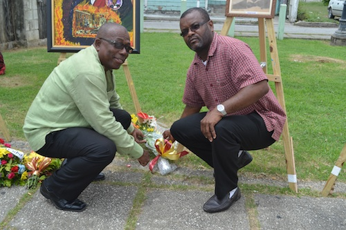 MP Trevor Prescod (left) and Peter Philips laying wreaths on behalf of the Barbados Labour Party.