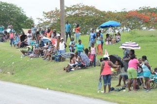 Residents along Junior Kadooment route