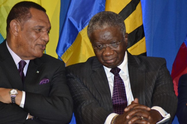Prime Minister Freundel Stuart (right) in discussion with his Bahamian counterpart Perry Christie at this evening's opening ceremony in Antigua.