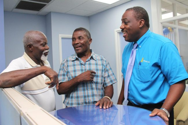 General manager of Beacon (Barbados) Brian Hennis (right) interacting with Ulric Cain (left) and Franklyn Campbell, two of the members who have been with the company the longest.